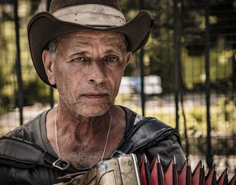 HDR Portrait of Man with Accordion