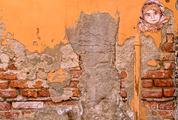 Cracked Concrete Brick Wall with Graffiti