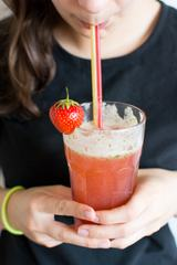 Woman Drinking Homemade Fresh Strawberry Lemonade
