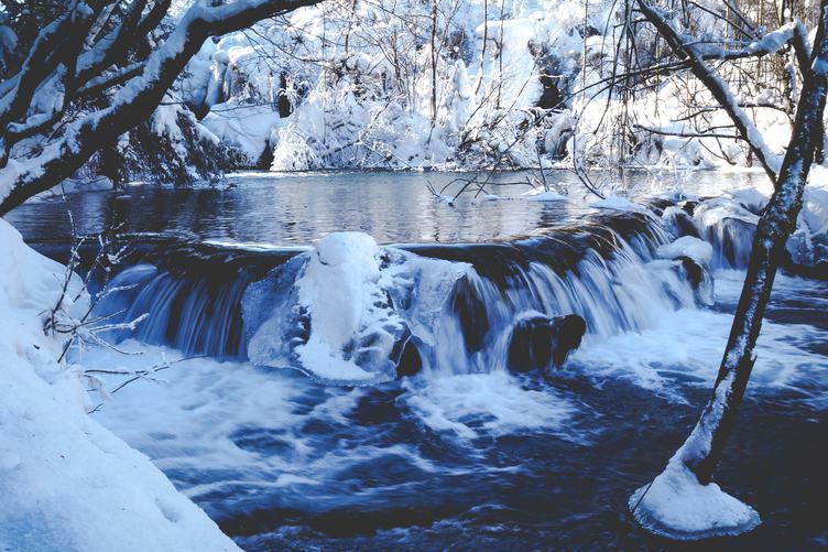 Small Waterfall in Winter Landscape