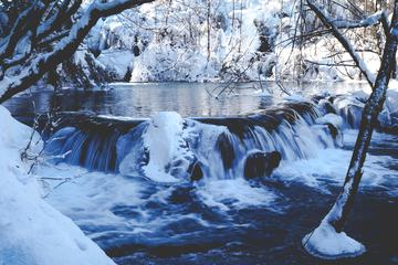 Small Waterfall in Winter Landscape