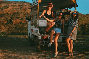 Three Young Women on Pickup Truck