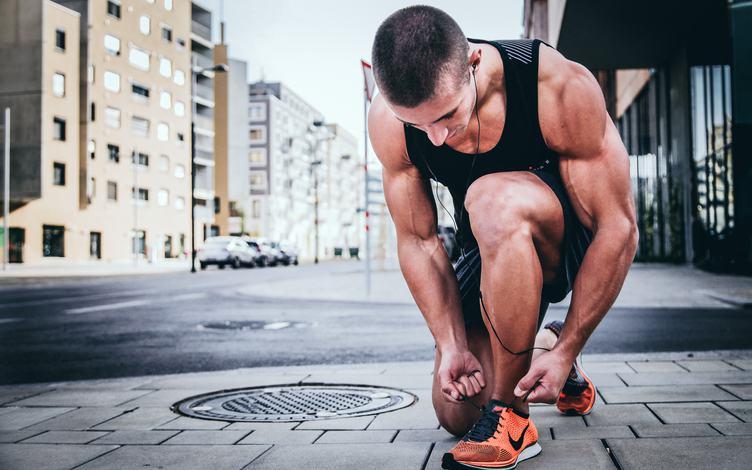Athlete Tying His Shoelace
