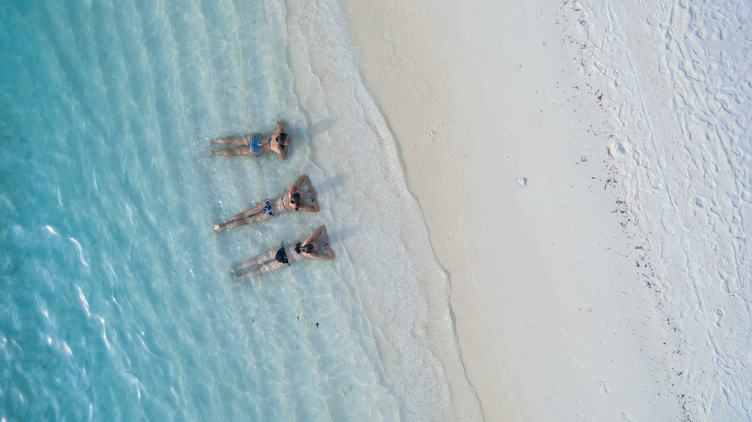 Top View of Three Woman in Water on the Beach