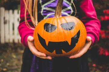 Girl Holding Halloween Pumpkin
