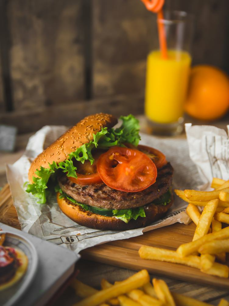 American Style Burger with French Fries and Orange Juice
