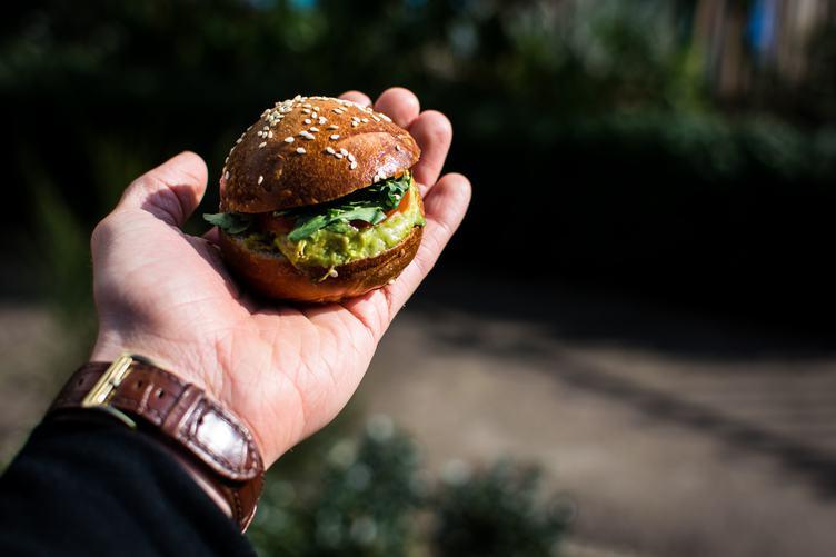 Man Holding a Mini Burger