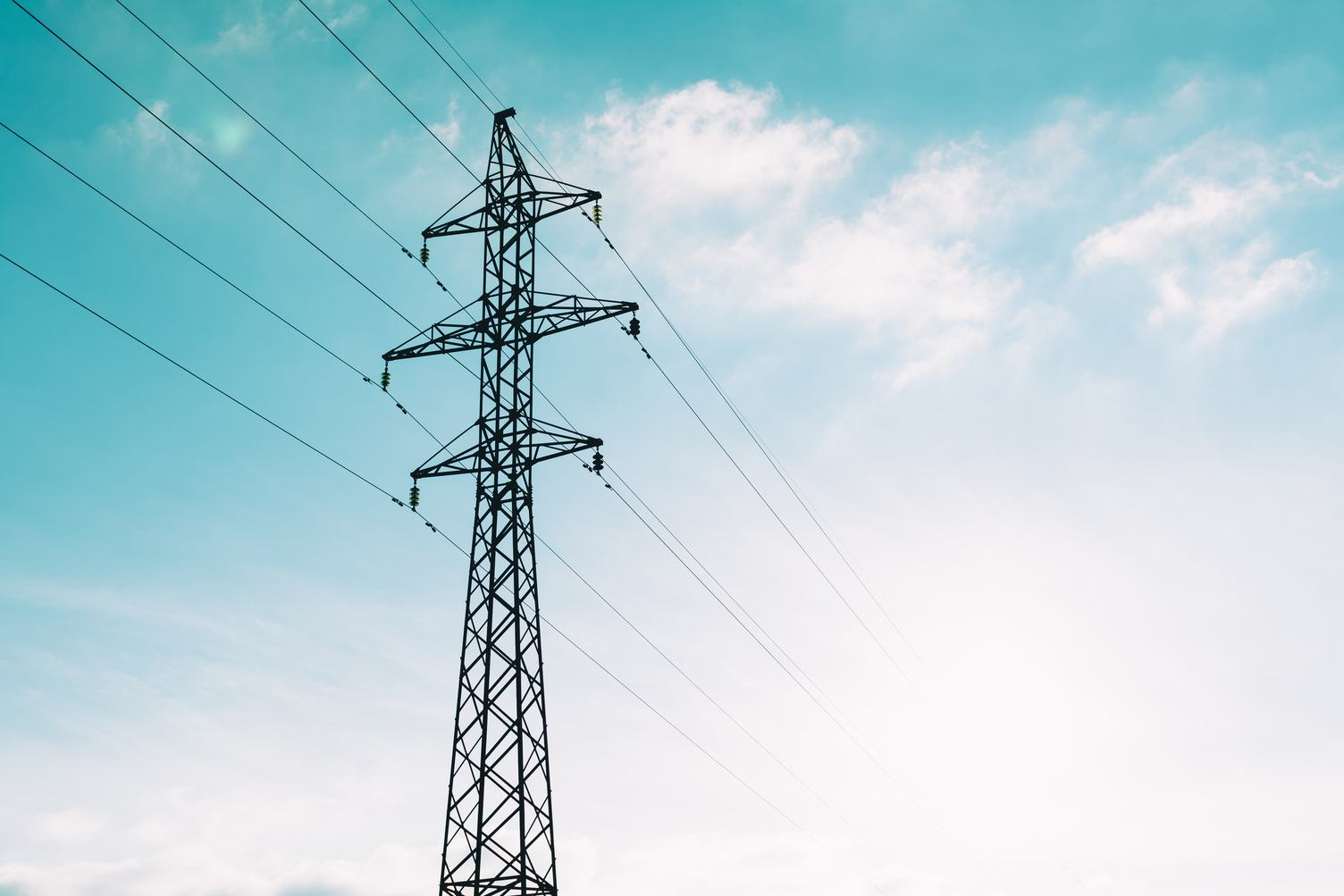 High Voltage Pole against Blue Sky