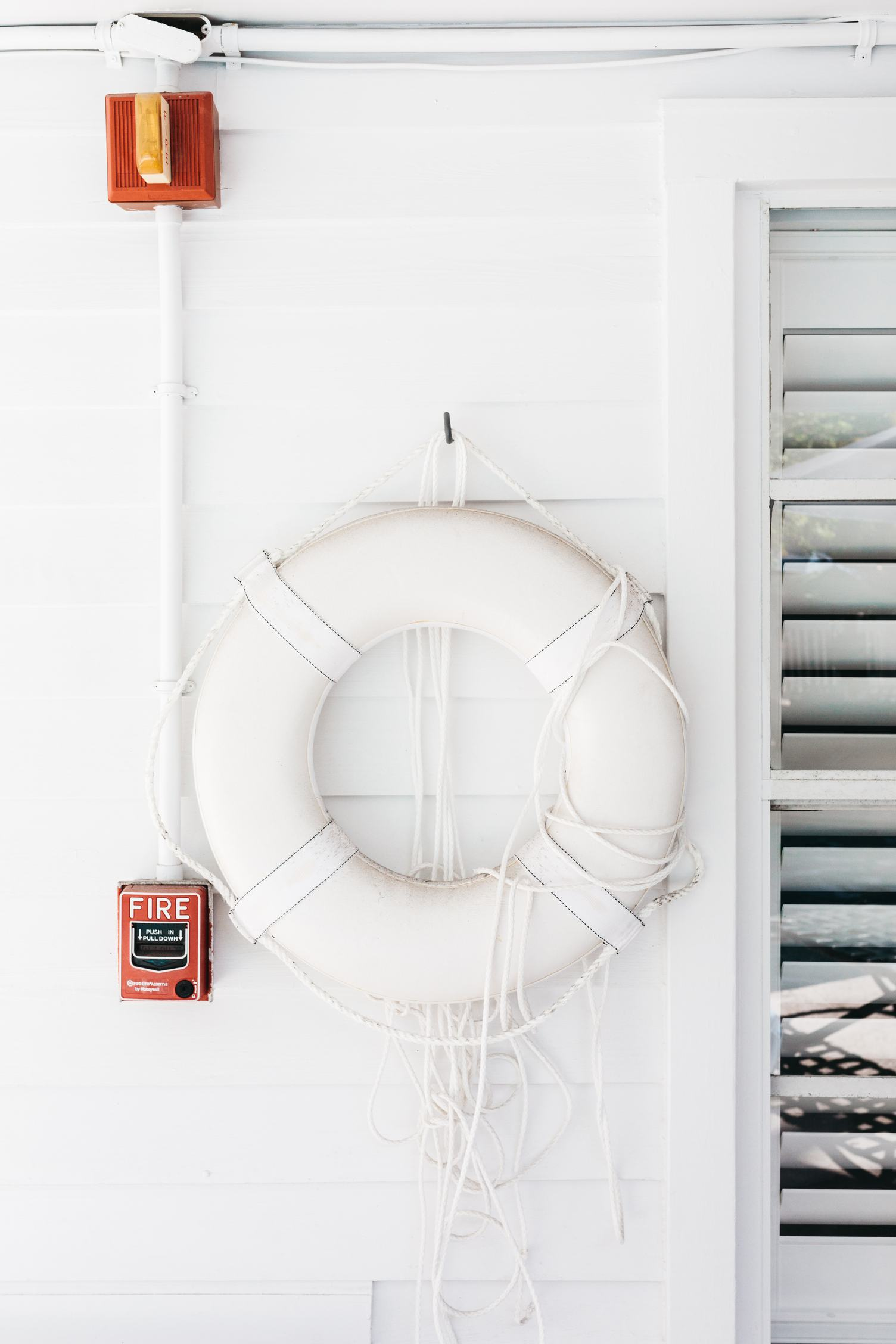 White Lifebuoy Hanging on the Wall