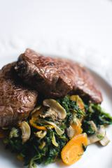 Close View of Beef Steak with Spinach
