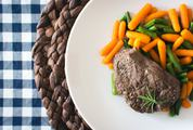Top View of Steak with Mini Carrots and Green Beans