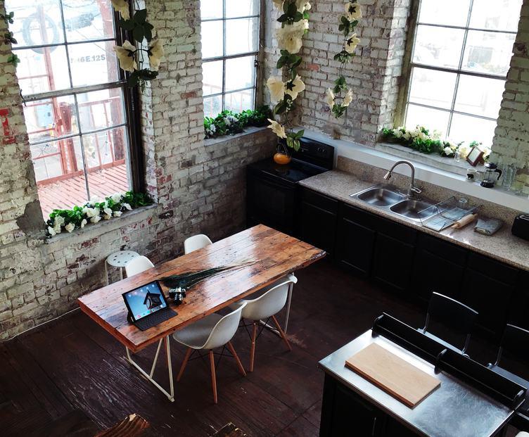 Kitchen in a Loft with Brick Walls