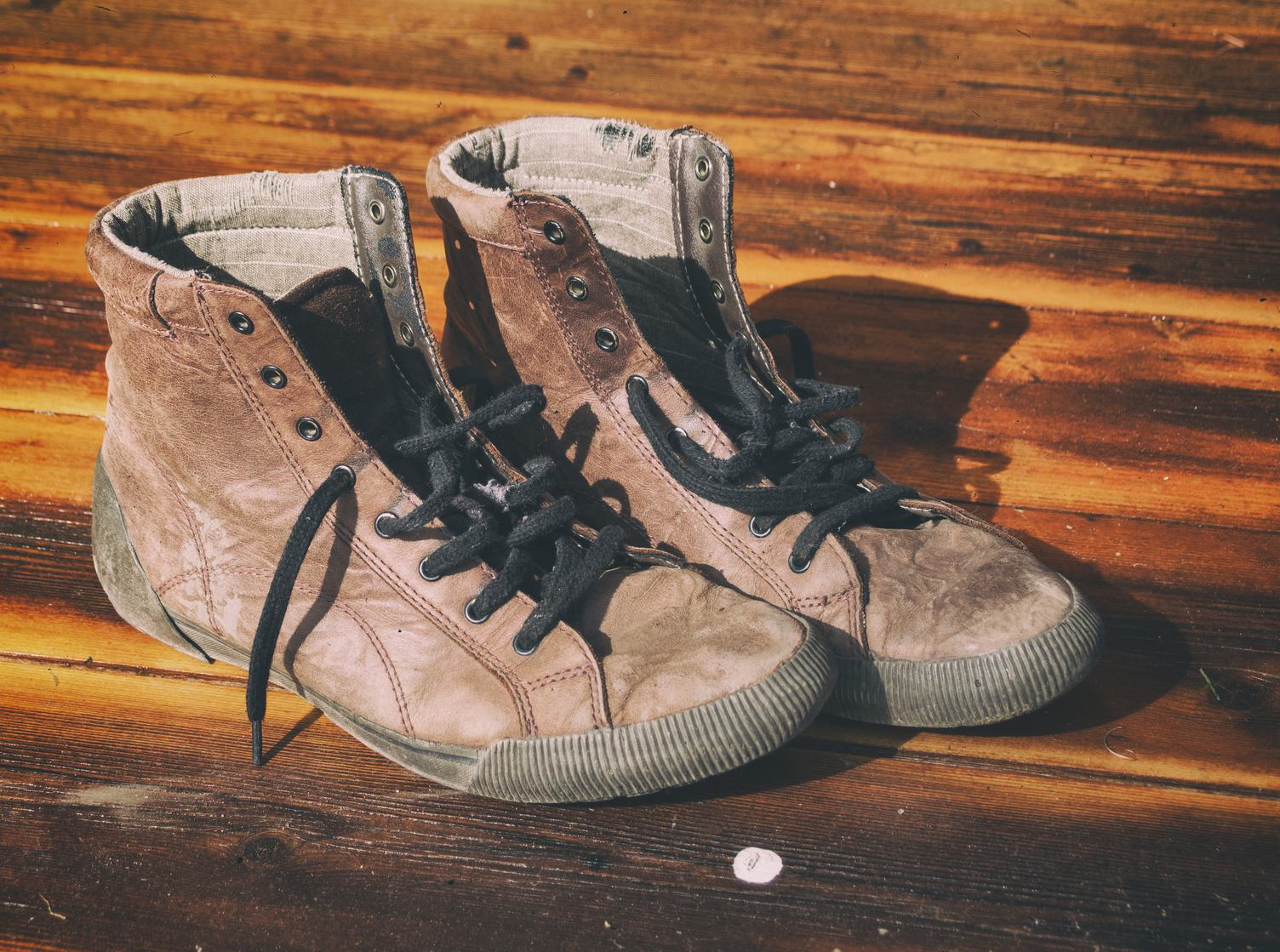 Pair of Old Dirty Brown Leather Shoes