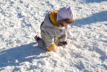 Child Playing on Snow