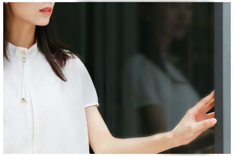 Young Woman Standing Wearing White Shirt