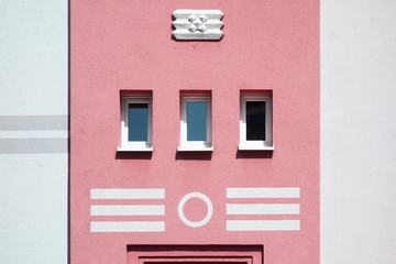 Pastel Pink Building with Small Windows