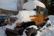 Jeep Covered with Snow