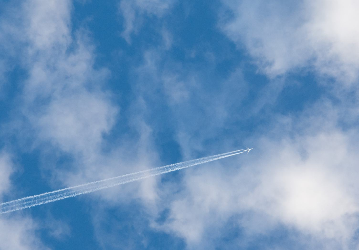 Plane Flying against Cloudy Sky