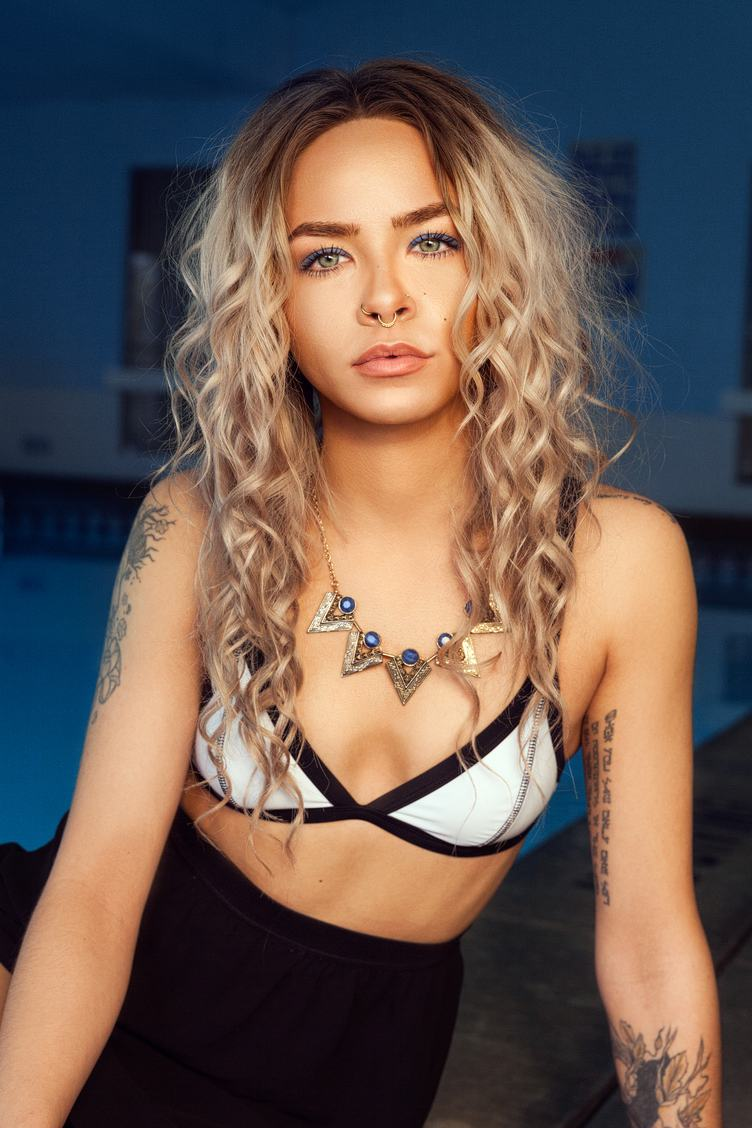 Blonde with Curly Hair and Tattoos in a Bikini