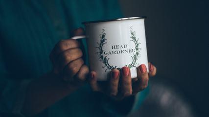 Metal Cup in Women's Hands