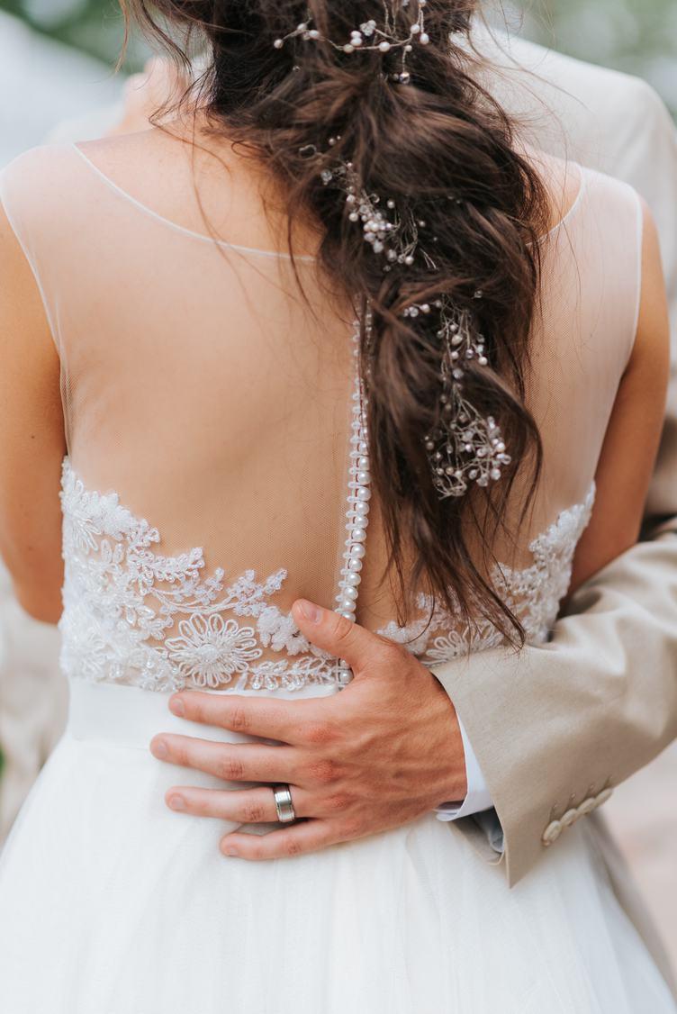 The Groom Hugs the Bride