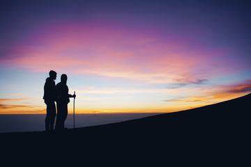 Couple Enjoying Sunset in the Mountains