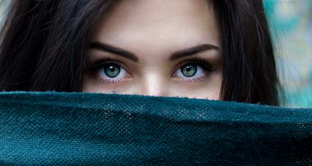 Portrait of Young Brunette Woman with Green Eyes