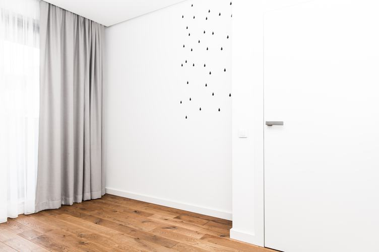 Room with Black Rain Drops on the White Wall