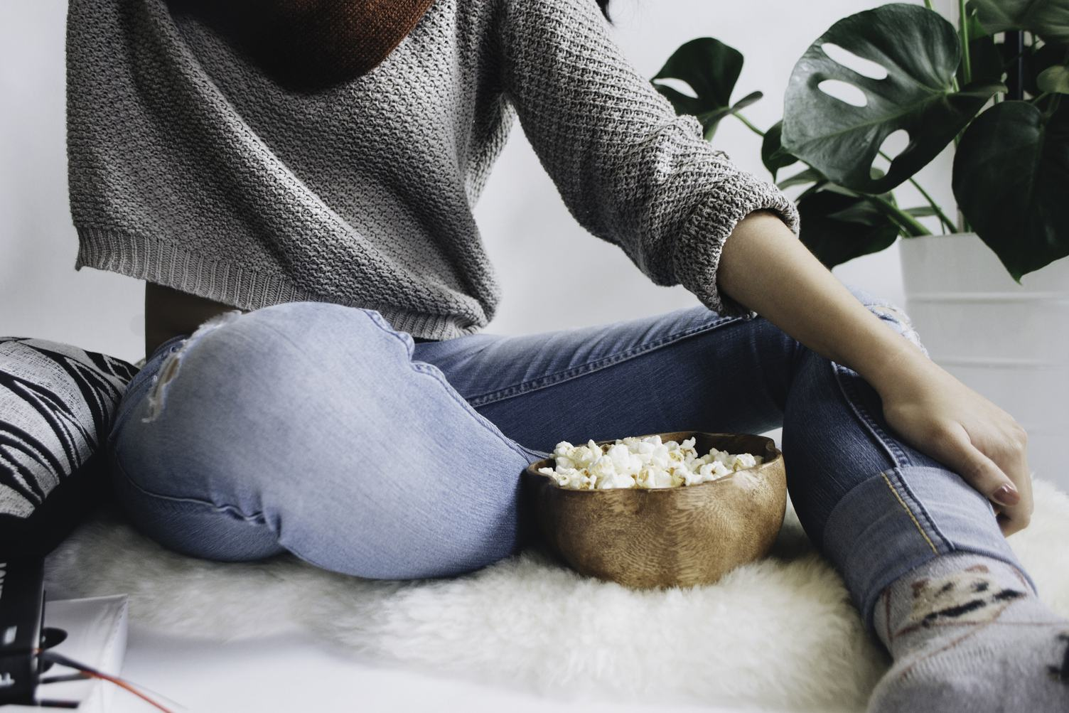 Woman with a Large Wooden Bowl of Popcorn