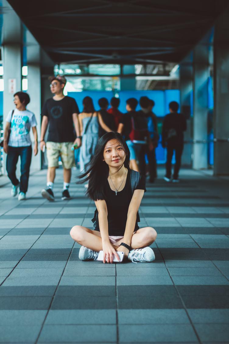 Girl Sitting on the Sidewalk