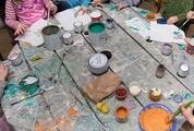 Children are Painting at the Table