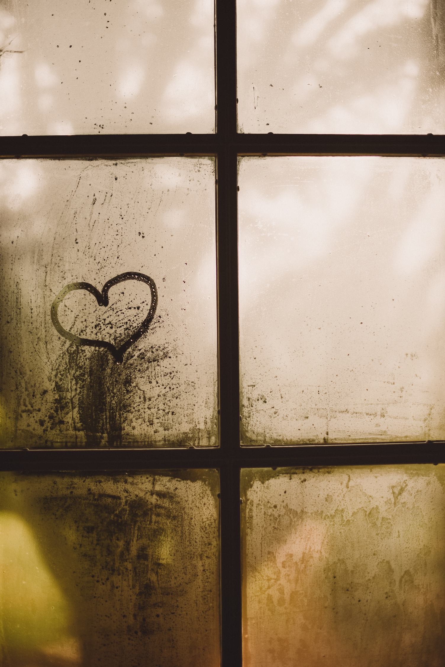 A Heart Painted on a Misted Window
