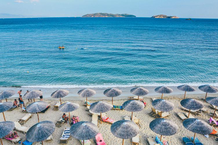 Beach Scene with Beautiful Turquoise Sea and Umbrellas