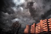 Block of Flat against Grey Dramatic Sky