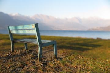 Bench by the Lake in the Mountains