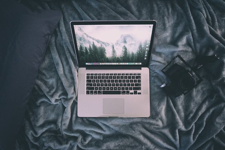 MacBook and Lumix Camera on Gary Blanket