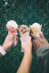 Hands Holding Ice Cream Waffle Cone