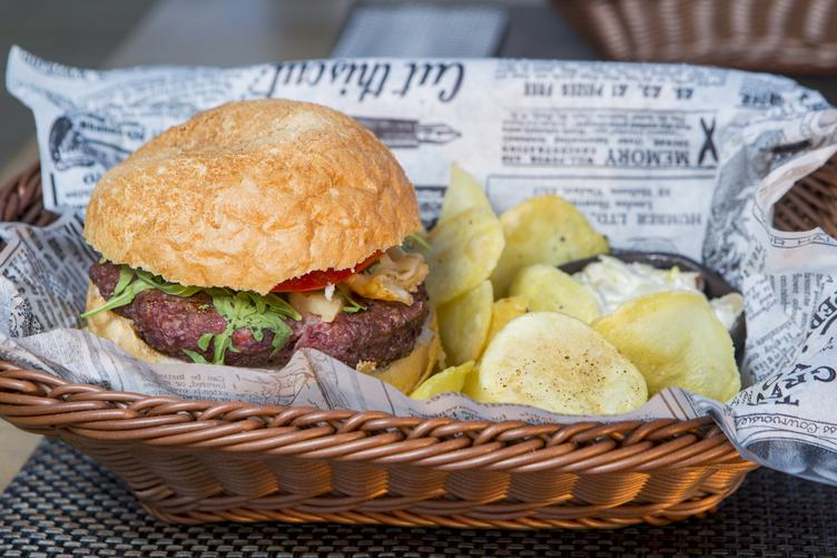 Delicious Burger and Fries in a Basket