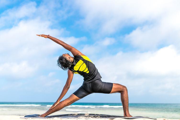 Man Practice Yoga on the Beach