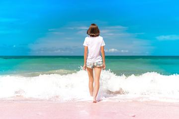 Girl Standing in Water on Seashore