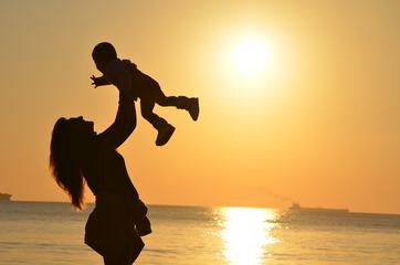Mother with her Child on The Beach, Sunset