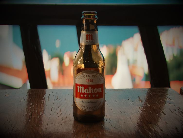 Beer Bottle on Wooden Table