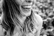 Outdoor Portrait of a Beautiful Happy Smiling Young Woman