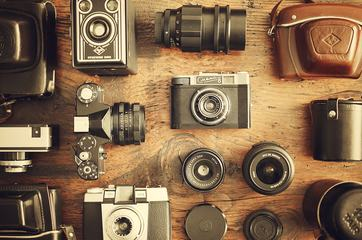 Retro Cameras and Lenses on the Wooden Table, Flat Lay