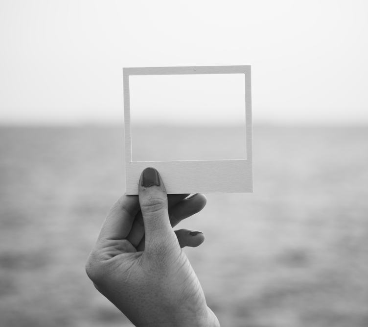 Female Hand Holding Empty Frame