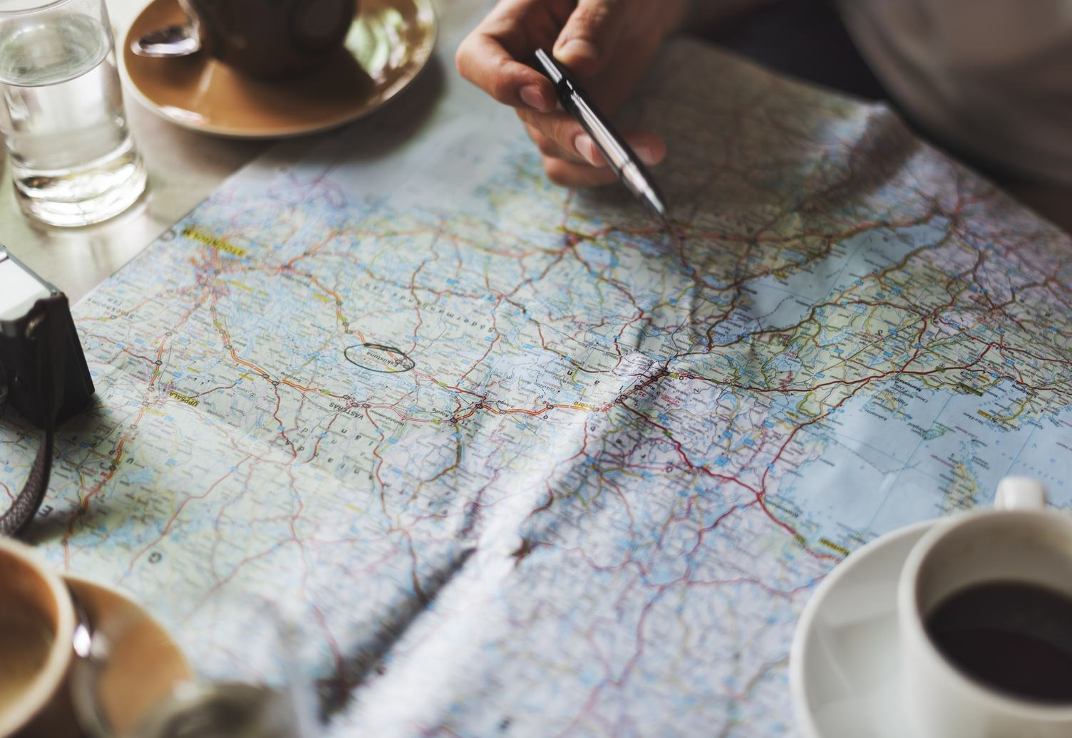 Sitting with a Map and a Coffee