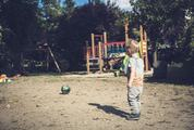 Boy on  the Playground Standing Back