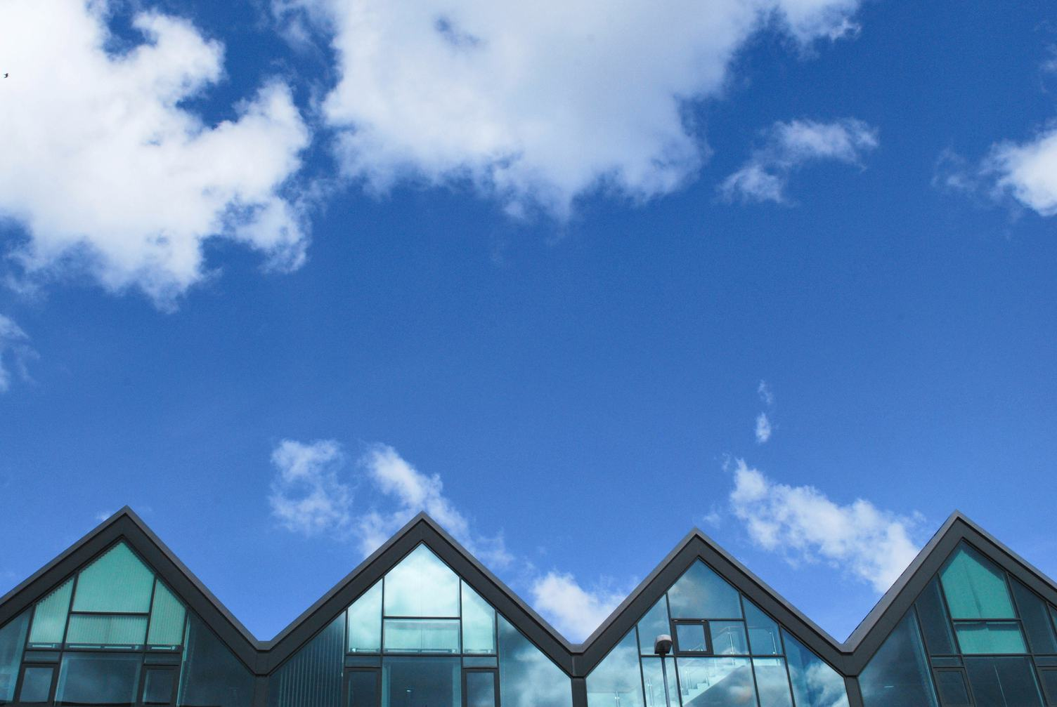 Glass Buildings against Blue Sky