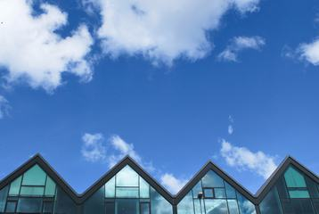 Glass Buildings against Blue Sky