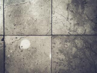 Grunge Grey Tiles on the Floor
